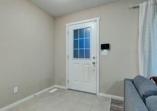 Photo 3: 40 EVANSRIDGE Court NW in Calgary: Evanston Row/Townhouse for sale : MLS®# A1095762