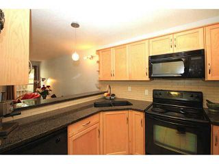 Photo 2: 161 76 GLAMIS Green SW in CALGARY: Glamorgan Stacked Townhouse for sale (Calgary)  : MLS®# C3572473
