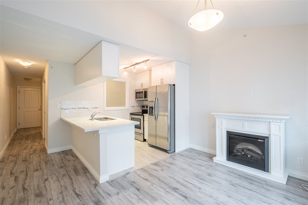 """Photo 5: Photos: 409 5650 201A Street in Langley: Langley City Condo for sale in """"Paddington Station"""" : MLS®# R2566139"""