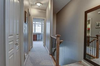 Photo 11: 7 124 Rockyledge View NW in Calgary: Rocky Ridge Row/Townhouse for sale : MLS®# A1111501