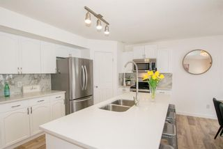 Photo 13: 186 Somerside Crescent SW in Calgary: Somerset Detached for sale : MLS®# A1085183