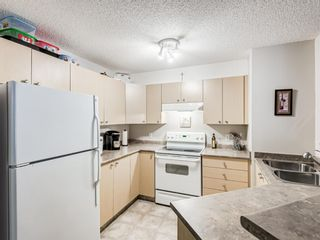 Photo 3: 8425 304 Mackenzie Way SW: Airdrie Apartment for sale : MLS®# A1085933