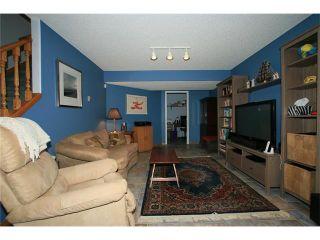 Photo 36: 108 WEST TERRACE Point(e): Cochrane House for sale : MLS®# C4077226