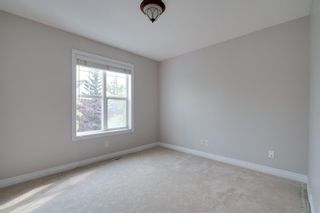 Photo 20: 2 10 St Julien Drive SW in Calgary: Garrison Woods Row/Townhouse for sale : MLS®# A1146015