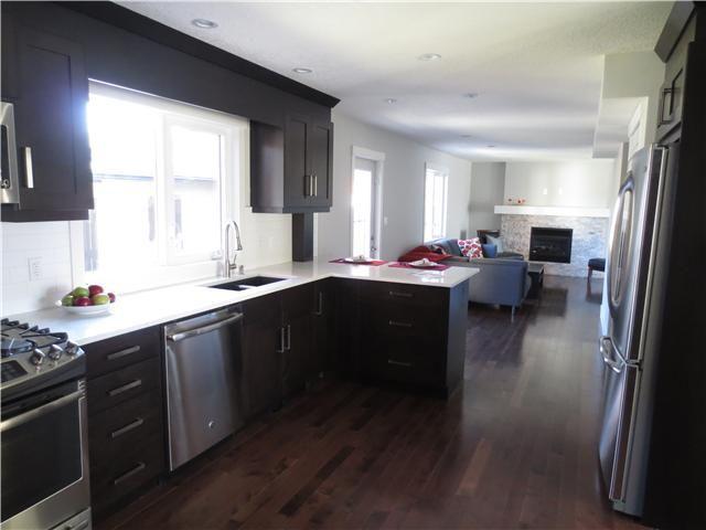 Photo 14: Photos: 1048 LAKE TWINTREE Drive SE in Calgary: Lake Bonavista Residential Detached Single Family for sale : MLS®# C3641174