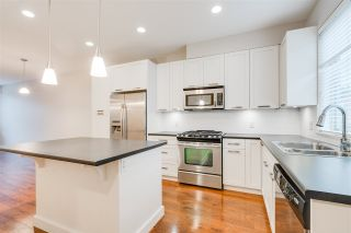 """Photo 1: 66 34248 KING Road in Abbotsford: Poplar Townhouse for sale in """"Argyle"""" : MLS®# R2338605"""