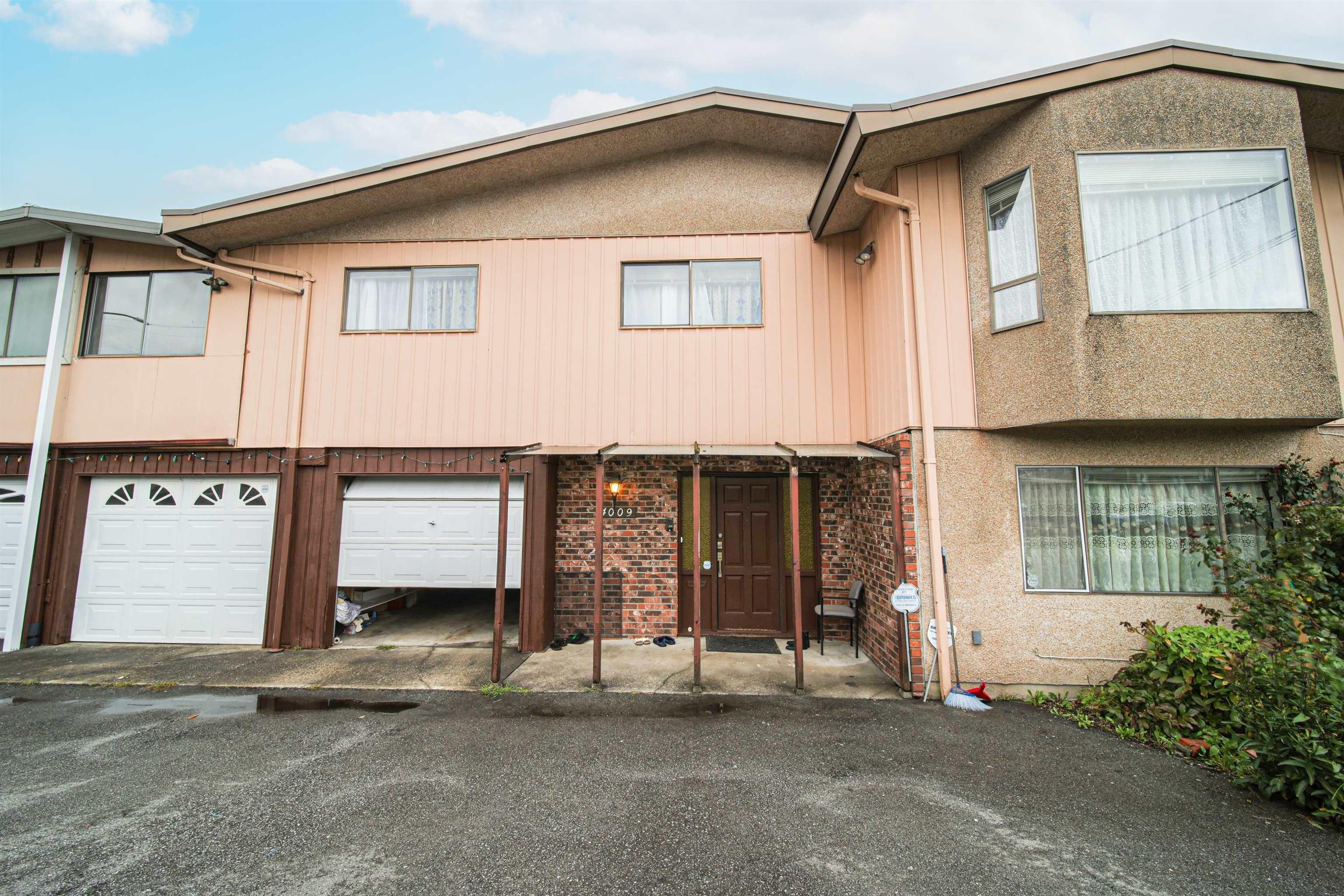 Main Photo: 4009 PRICE Street in Burnaby: Garden Village 1/2 Duplex for sale (Burnaby South)  : MLS®# R2621878