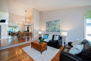 Photo 2: 208 Strathcona Mews SW in Calgary: Strathcona Park Detached for sale : MLS®# A1094826