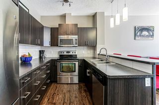 Photo 9: 1020 10 Auburn Bay Avenue SE in Calgary: Auburn Bay Row/Townhouse for sale : MLS®# A1095152