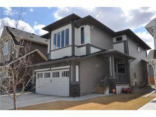Photo 1: 109 HEARTLAND Way: Cochrane House for sale : MLS®# C4044449