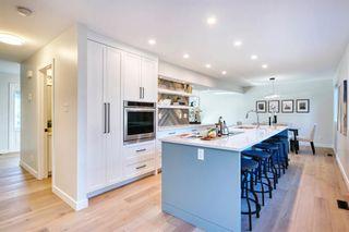 Photo 4: 1808 104 Avenue SW in Calgary: Braeside Detached for sale : MLS®# A1151044
