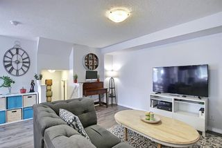 Photo 13: 110 Hillcrest Gardens SW: Airdrie Row/Townhouse for sale : MLS®# A1090717
