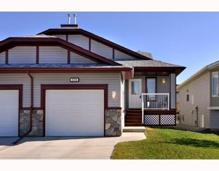Photo 1: 579 STONEGATE Way NW: Airdrie Residential Attached for sale : MLS®# C3397152