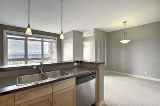 Photo 13: 4 145 Rockyledge View NW in Calgary: Rocky Ridge Apartment for sale : MLS®# A1041175