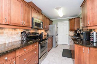 "Photo 6: 211 14998 101A Avenue in Surrey: Guildford Condo for sale in ""Cartier Place"" (North Surrey)  : MLS®# R2163848"