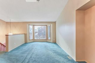 Photo 6: 51 SANDRINGHAM Way NW in Calgary: Sandstone Valley House for sale