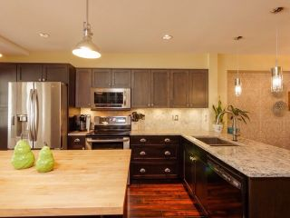 """Photo 6: 8 6651 203 Street in Langley: Willoughby Heights Townhouse for sale in """"Sunscape"""" : MLS®# F1446501"""