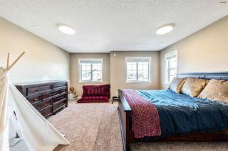 Photo 23: 494 Boulder Creek Way SE: Langdon Semi Detached for sale : MLS®# A1148702