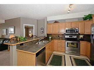 Photo 3: 424 15 EVERSTONE Drive SW in CALGARY: Evergreen Condo for sale (Calgary)  : MLS®# C3611347