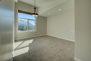 Photo 4: 410 1105 Spring Creek Drive: Canmore Apartment for sale : MLS®# A1116149