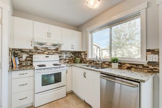Photo 4: 915 ARBOUR LAKE Road NW in Calgary: Arbour Lake Detached for sale : MLS®# A1031493