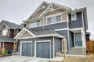 Photo 1: 570 River Heights Crescent: Cochrane Semi Detached for sale : MLS®# A1090524