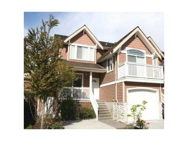 """Main Photo: 18 1506 EAGLE MOUNTAIN Drive in Coquitlam: Westwood Plateau Townhouse for sale in """"RIVER ROCK"""" : MLS®# V884983"""