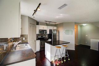 Photo 3: 50 Auburn Bay Common SE in Calgary: Auburn Bay Row/Townhouse for sale : MLS®# A1128928