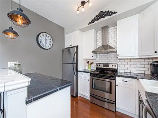 Photo 9: 35 43 SPRINGBOROUGH Boulevard SW in Calgary: Springbank Hill House for sale : MLS®# C4083171