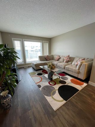 Photo 2: 7010 NEWSON Road in Edmonton: Zone 27 Attached Home for sale : MLS®# E4228567