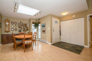 """Photo 4: 404 2733 ATLIN Place in Coquitlam: Coquitlam East Condo for sale in """"ATLIN COURT"""" : MLS®# R2232992"""