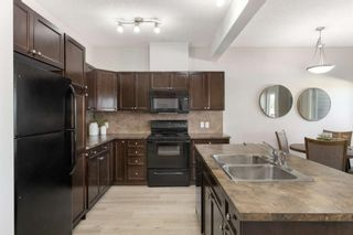 Photo 8: 407 620 Luxstone Landing SW: Airdrie Row/Townhouse for sale : MLS®# A1121530