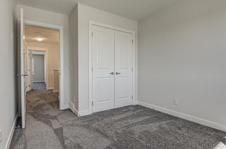 Photo 23: 132 Creekside Drive SW in Calgary: C-168 Semi Detached for sale : MLS®# A1144861