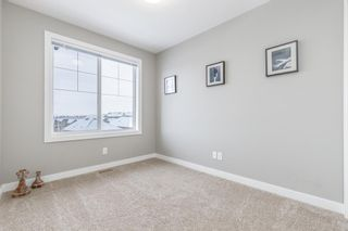 Photo 19: 703 Jumping Pound Common: Cochrane Row/Townhouse for sale : MLS®# A1064956