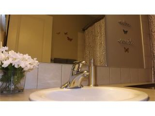 Photo 13: 155 SUNSET Close: Cochrane House for sale : MLS®# C4037159