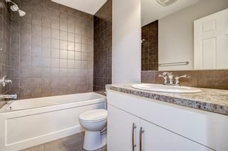 Photo 28: 129 Windstone Park SW: Airdrie Row/Townhouse for sale : MLS®# A1137155