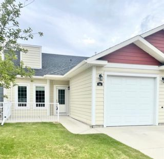 Photo 1: 44 Sunrise Place NE: High River Row/Townhouse for sale : MLS®# A1059661
