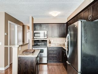 Photo 8: 408 2200 Woodview Drive SW in Calgary: Woodlands Row/Townhouse for sale : MLS®# A1087081