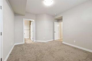 Photo 39: 910 WOOD Place in Edmonton: Zone 56 House Half Duplex for sale : MLS®# E4239285