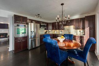 Photo 11: 1072 Acadia Drive SE in Calgary: Lake Bonavista Detached for sale : MLS®# A1058611