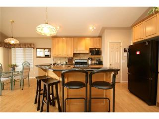 Photo 14: 313 GLENEAGLES View: Cochrane House for sale : MLS®# C4047766