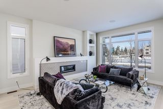 Photo 5: 106 Valour Circle SW in Calgary: Currie Barracks Detached for sale : MLS®# A1073300