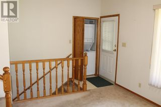 Photo 5: 11 Erminedale Bay N in Lethbridge: House for sale : MLS®# A1093060