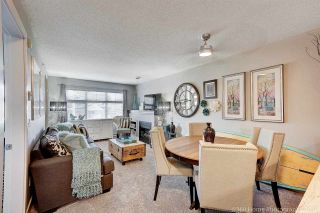 """Photo 1: 410 6500 194 Street in Surrey: Cloverdale BC Condo for sale in """"Sunset Grove"""" (Cloverdale)  : MLS®# R2331688"""