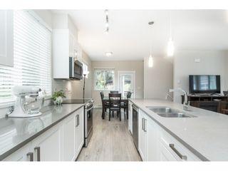 "Photo 14: 102 218 BEGIN Street in Coquitlam: Maillardville Townhouse for sale in ""Begin Square"" : MLS®# R2504206"