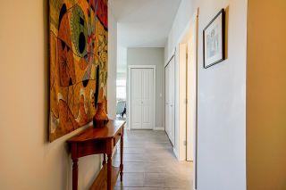 "Photo 5: 408 15299 17A Avenue in Surrey: King George Corridor Condo for sale in ""Flagstone Walk"" (South Surrey White Rock)  : MLS®# R2596476"
