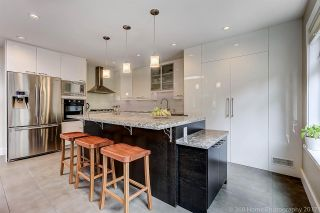 """Photo 7: 7720 TEAKWOOD Place in Vancouver: Champlain Heights Townhouse for sale in """"WOODLANDS"""" (Vancouver East)  : MLS®# R2173091"""