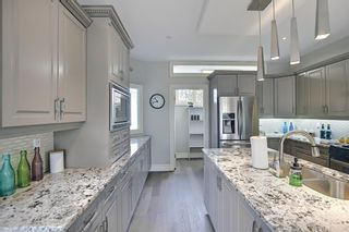 Photo 5: 430 Sierra Madre Court SW in Calgary: Signal Hill Detached for sale : MLS®# A1100260