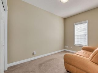 Photo 24: 81 Somme Boulevard SW in Calgary: Garrison Woods Residential for sale : MLS®# A1072185
