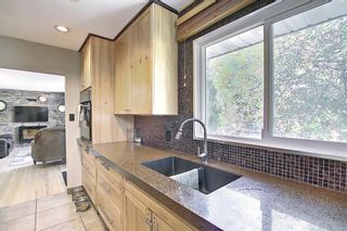 Photo 12: 5604 Buckthorn Road NW in Calgary: Thorncliffe Detached for sale : MLS®# A1119366